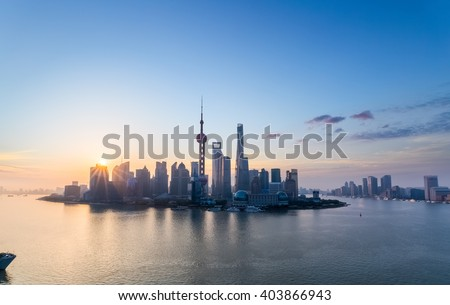 charming shanghai in sunrise, pudong skyline and huangpu river, China.