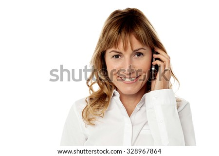Charming smiling woman on the phone - stock photo