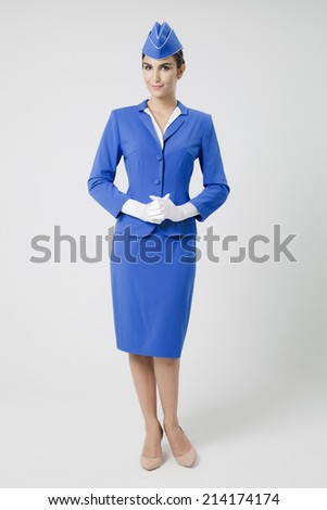 Charming Stewardess Dressed In Blue Uniform - stock photo