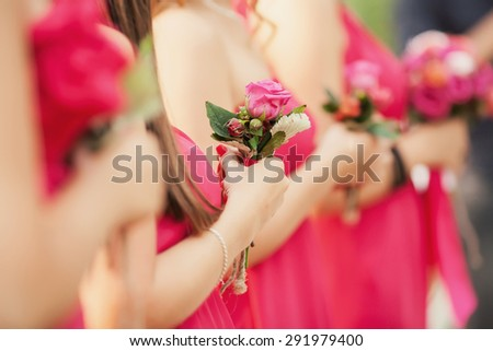 Charming witness in pink dress with a bouquet of flowers