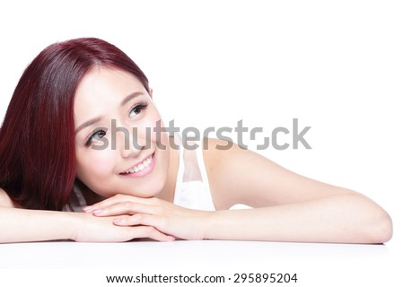 Charming woman face Smile close up while lying isolated on white background, asian girl - stock photo