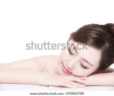 Charming woman face Smile enjoy spa and massage while lying isolated on white background, asian girl