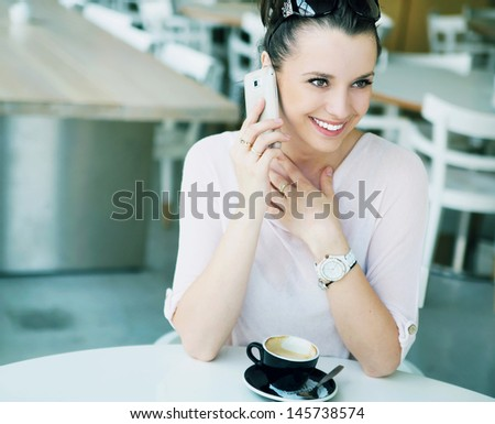 Charming woman in a restaurant - stock photo