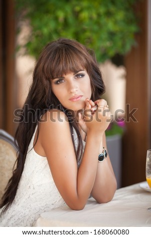 Charming woman in cafe, pretty young woman sitting in restaurant and happy smiling. France. Monte Carlo. Italy. - stock photo
