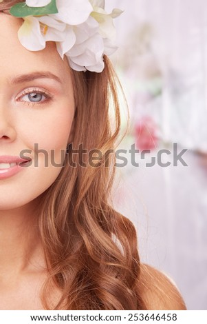 Charming woman in spring environment - stock photo