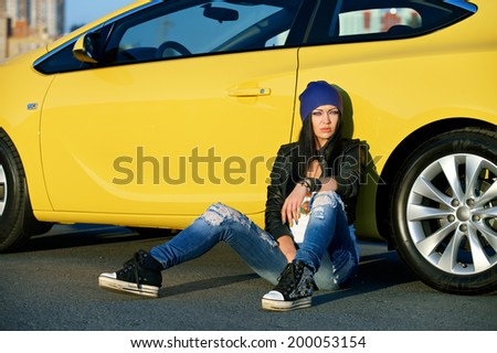 charming woman in the car - stock photo