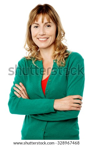 Charming woman posing with folded arms