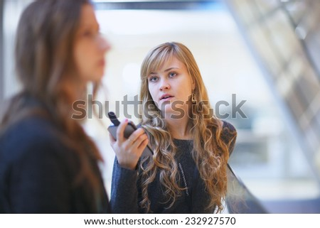 Charming woman speaking with a partner - stock photo