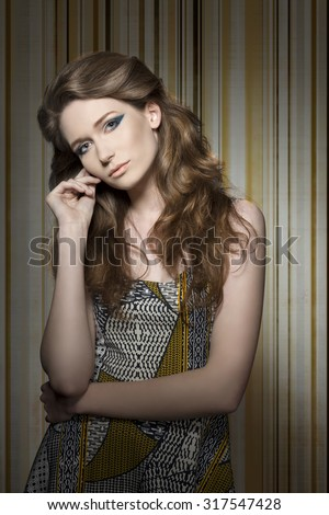 charming woman with long natural hair, cute blue make-up and lovely vintage dress. Looking in camera  - stock photo