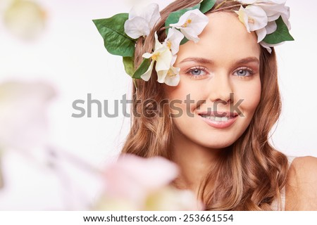 Charming woman with natural makeup wearing floral wreath - stock photo