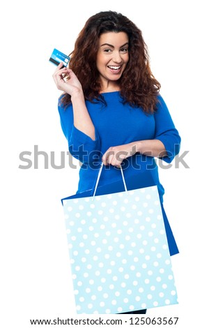 Charming woman with shopping bags flashing her credit card