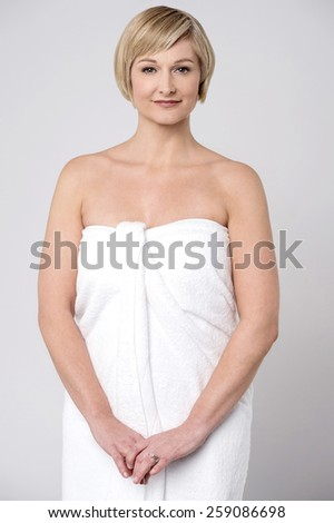 Charming woman wrapped in towel - stock photo