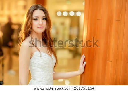 Charming young bride happy.  back light - stock photo