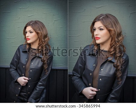 Charming young brunette woman in black leather outfit, coat and trousers, with dark gray wall on background. Sexy gorgeous young woman. Full length portrait of a sensual woman with long curly hair - stock photo
