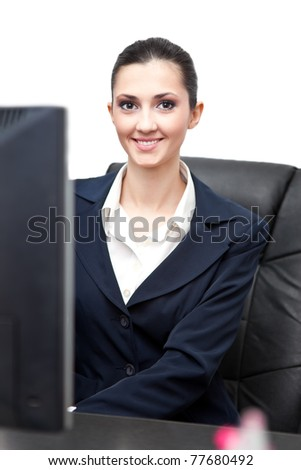 charming young businesswoman in office - stock photo