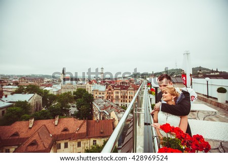charming young couple admiring the landscape - stock photo