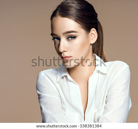 Charming young fashion model / photo-composition of brunette girl on beige background - stock photo