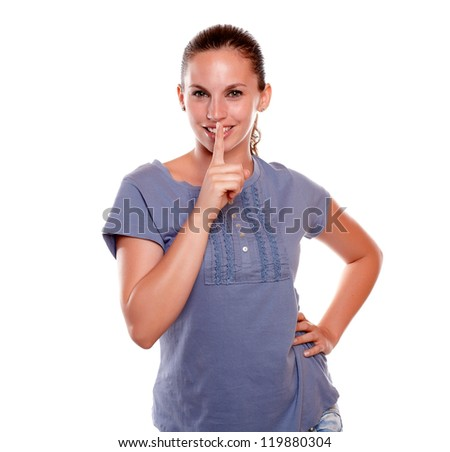 Charming young female requesting to you silence on blue shirt against white background - stock photo