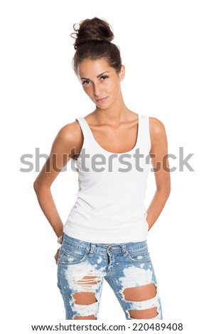 Charming young girl in jeans and a white T-shirt. Isolation on a white background.  - stock photo