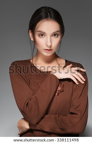 charming young lady posing with crossed hands - stock photo
