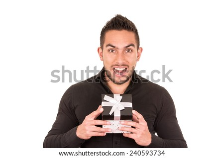 charming young man holding a gift box isolated on white - stock photo