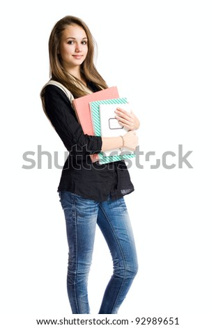 Charming young student girl holding exercise books. - stock photo