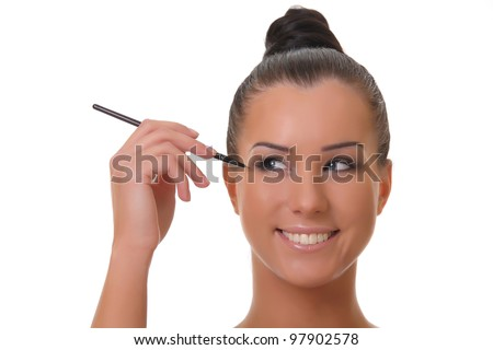 Charming young woman applying blusher eyelid close up , on white  background. - stock photo