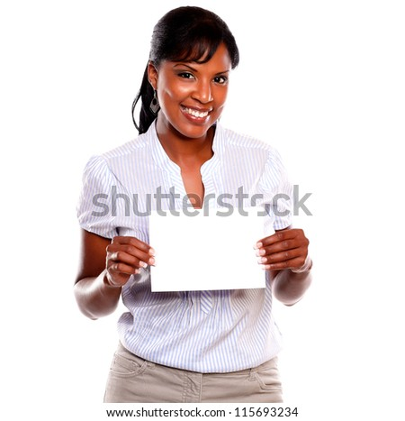Charming young woman holding a white card on isolated background - copyspace - stock photo