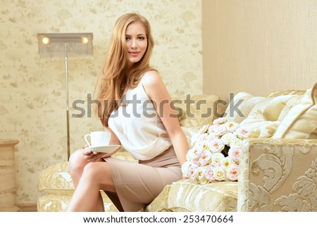 Charming young woman in a room with expensive classic interior. Interior. Furniture. - stock photo
