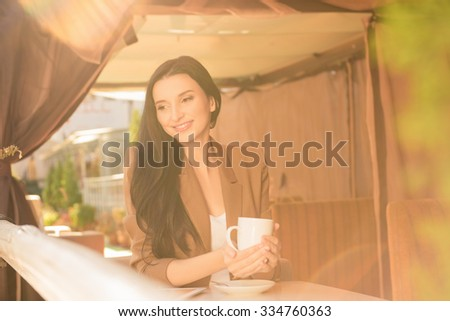 Charming young woman on coffee break