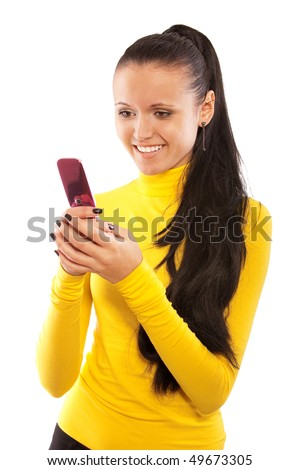Charming young woman reads sms on mobile phone, it is isolated on white background.