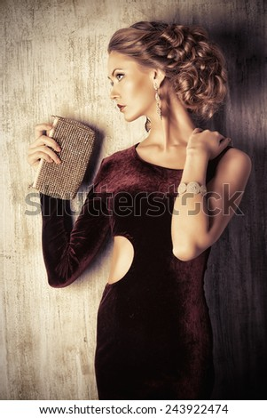 Charming young woman wearing elegant evening dress and beautiful hairstyle. Jewellery.  Fashion shot. - stock photo