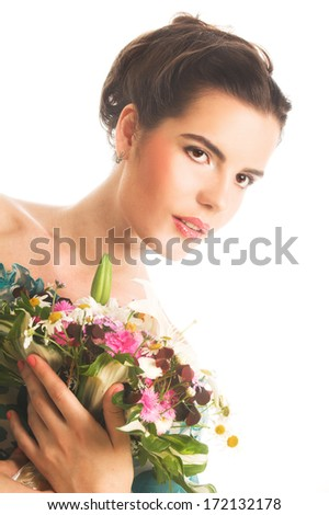 Charming young woman with flowers in her hands