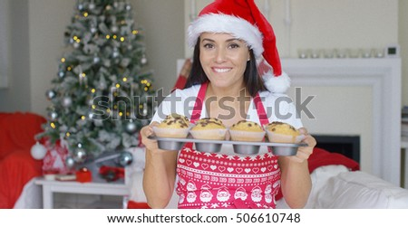 Charming young woman with fresh baked cookies
