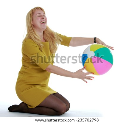 Charming young woman with multi-colored ball.White background, isolated photo. - stock photo