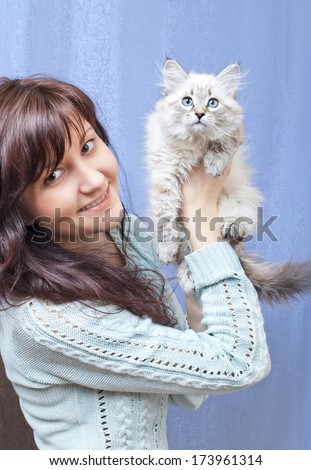 Charming young woman with sibirsky nevsky kitten  - stock photo