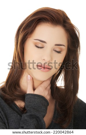 Charming young woman with terrible throat pain. - stock photo