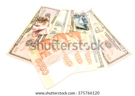 charred russian banknotes and dollars on white background
