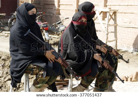 CHARSADDA, PAKISTAN - FEB 15: Security stand alert to avoid untoward incident as security has been tighten after reopened Bacha Khan University terrorist attack on February 15, 2016 in Charsadda.