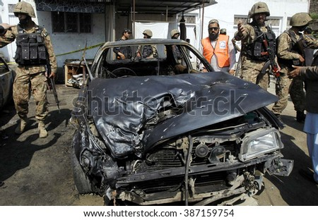 CHARSADDA, PAKISTAN - MAR 07: Security and rescue officials gather at the site after  suicide bomb explosion at local court building premises in Shabqadar on  March 07, 2016 in Charsadda.