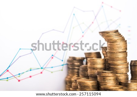 Chart and coins on white background - stock photo