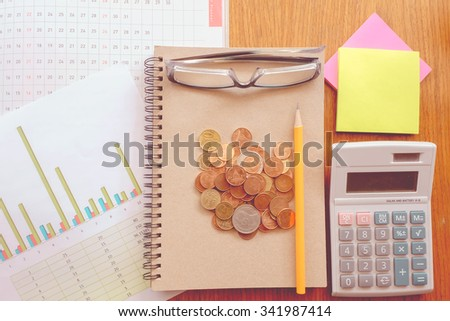 chart and money on wooden table with vintage style