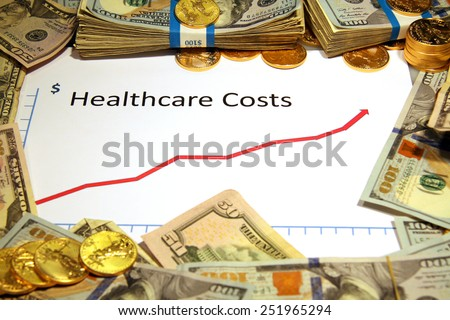 chart graph of health care costs up rising gold and money - stock photo