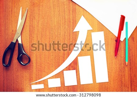 Chart of Business Increase With an Arrow Rising Up. Concept of Success With Paper Scrapbooking - stock photo