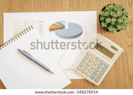 chart on the wooden table with vintage color style - stock photo