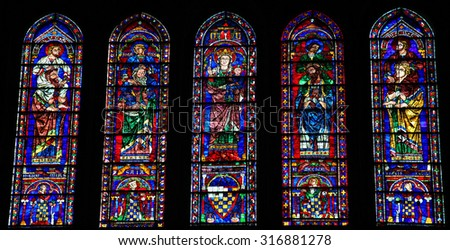 CHARTRES, FRANCE - JULY 21, 2015: Stained Glass with Mother Mary, the Four Evangelists and Four Prophets in the Cathedral of Our Lady of Chartres, France - stock photo