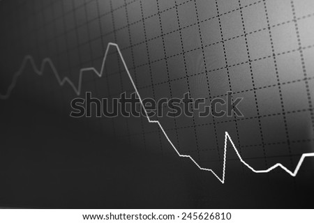 Charts and quotes on display. Display of Stock market quotes. Stock exchange rates. Earn profit chart and diagram. Computer screen live display. Display of Stock market quotes. Computer screen. - stock photo