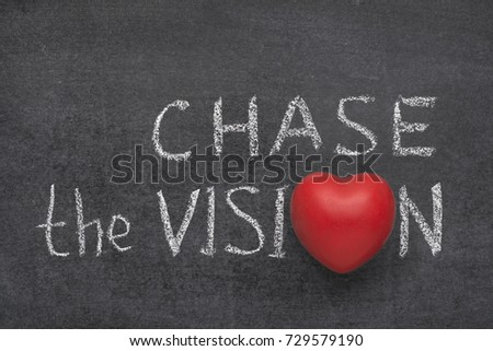 chase the vision phrase handwritten on blackboard with heart symbol instead of O