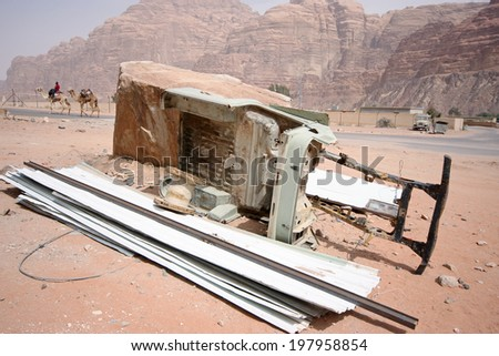 Chassis of a jeep and camels in the back - scene from a desert in Jordan - stock photo