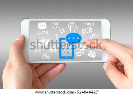 Chat bot and future marketing concept. Businessman hand holding white phone with chatbot application and infographic with gray aluminium background.